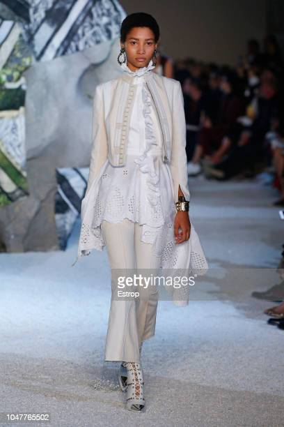 A model walks the runway during the Alexander McQueen Paris show as part of the Paris Fashion Week Womenswear Spring/Summer 2019 on October 1 2018 in...