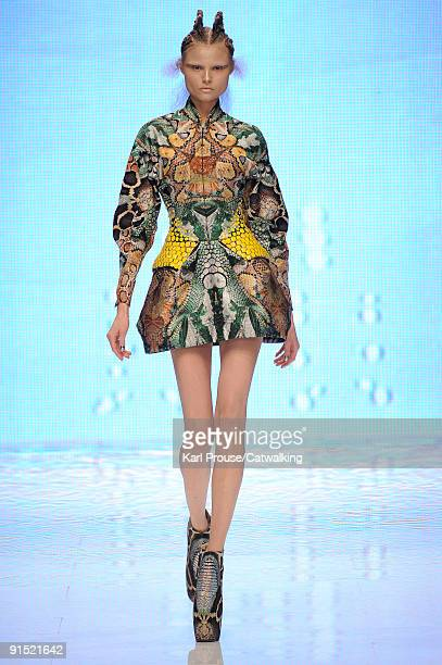 A model walks the runway during the Alexander McQueen Ready To Wear show as part of the Paris Womenswear Fashion Week Spring/Summer 2010 at Salle...
