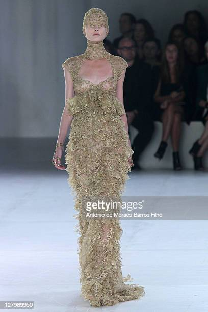 A model walks the runway during the Alexander McQueen Ready to Wear Spring / Summer 2012 show during Paris Fashion Week on October 4 2011 in Paris...