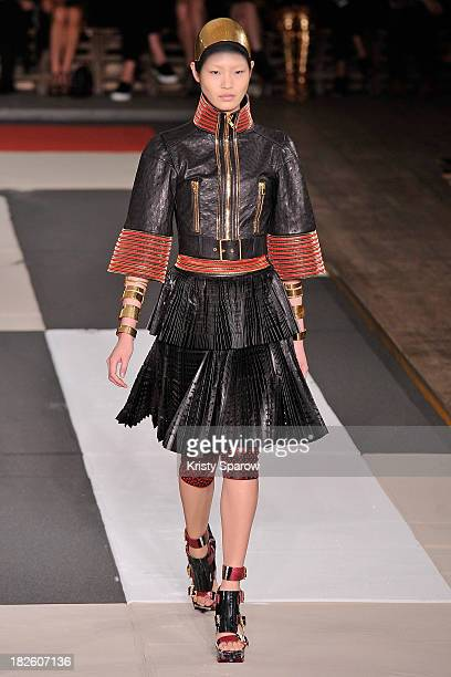 A model walks the runway during the Alexander McQueen show as part of Paris Fashion Week Womenswear Spring/Summer 2014 on October 1 2013 in Paris...