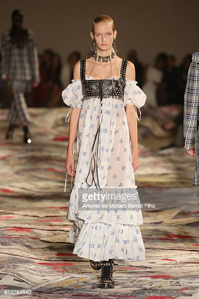A model walks the runway during the Alexander McQueen show as part of the Paris Fashion Week Womenswear Spring/Summer 2017 on October 3 2016 in Paris...
