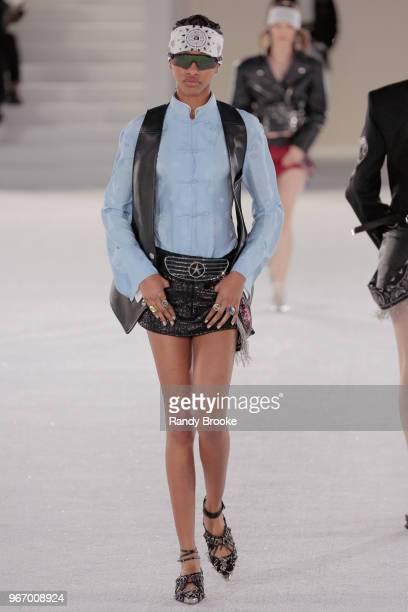 A model walks the runway during the Alexander Wang Resort Runway show June 2018 New York Fashion Week on June 3 2018 in New York City