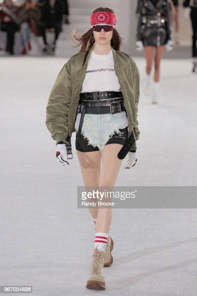 A model walks the runway during the Alexander Wang Resort Runway show June 2018 New York Fashion Week on June 3 2018 in New York City