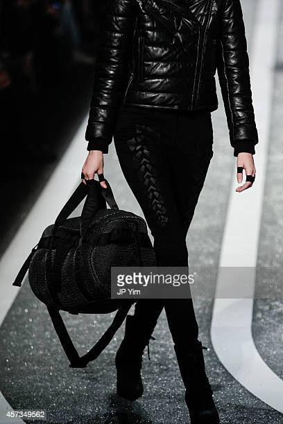 A model walks the runway during the Alexander Wang X HM Collection Launch at the Armory on the Hudson on October 16 2014 in New York City
