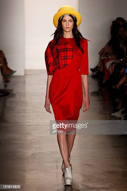 Model walks the runway during the Alexandre Herchcovitch show during Spring 2013 Mercedes-Benz Fashion Week at Milk Studios on September 8, 2012 in...
