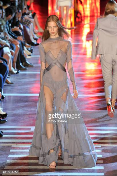 A model walks the runway during the Alexandre Vauthier show as part of Paris Fashion Week Haute Couture Fall/Winter 20142015 at Maison de la Radio on...