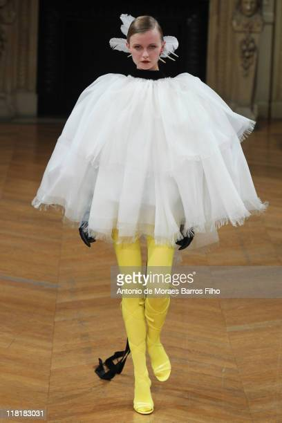 Model walks the runway during the Alexis Mabille Haute Couture Fall/Winter 2011/2012 show as part of Paris Fashion Week at Theatre du Chatelet on...
