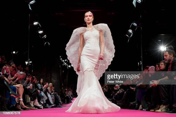 A model walks the runway during the Alexis Mabille Spring Summer 2019 show as part of Paris Fashion Week on January 22 2019 in Paris France