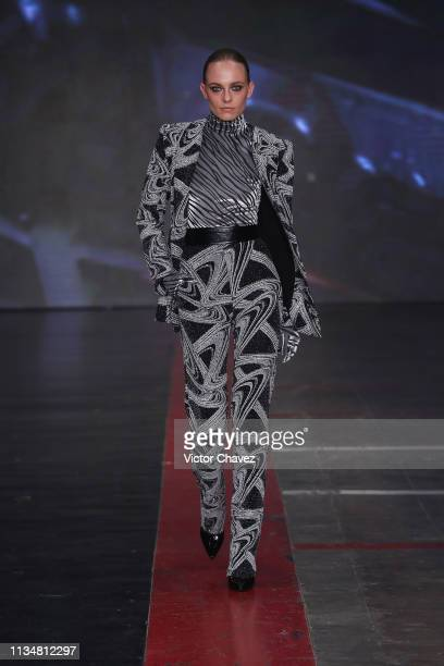 A model walks the runway during the Alfredo Martinez fashion show as part of the MercedesBenz Fashion Week Mexico Fall/Winter 2019 Day 3 at Fronton...