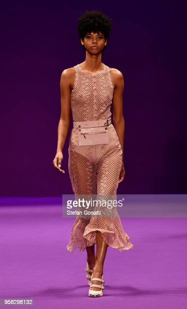 Model walks the runway during the Alice McCall show at Mercedes-Benz Fashion Week Resort 19 Collections at Carriageworks on May 14, 2018 in Sydney,...