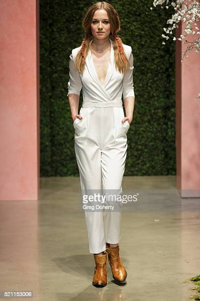A model walks the runway during the alice olivia By Stacey Bendet And Neiman Marcus Present SeeNowBuyNow Runway Show at NeueHouse Los Angeles on...