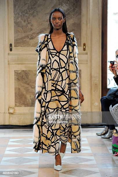A model walks the runway during the Allude show as part of Paris Fashion Week Womenswear Fall/Winter 2015/2016 on March 11 2015 in Paris France