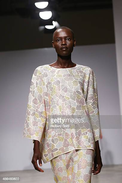 A model walks the runway during the Allude show as part of the Paris Fashion Week Womenswear Spring/Summer 2015 at Palais de Tokyo on October 1 2014...