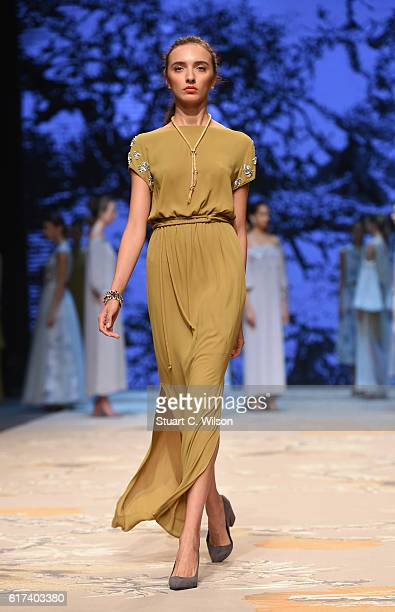 A model walks the runway during the Amal Al Raisi show at Fashion Forward Spring/Summer 2017 held at the Dubai Design District on October 23 2016 in...