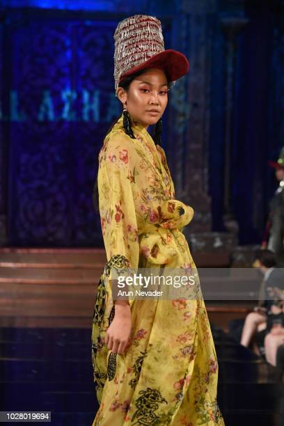 A model walks the runway during the AMAL AZHARI show at New York Fashion Week Powered By Art Hearts Fashion at The Angel Orensanz Foundation on...