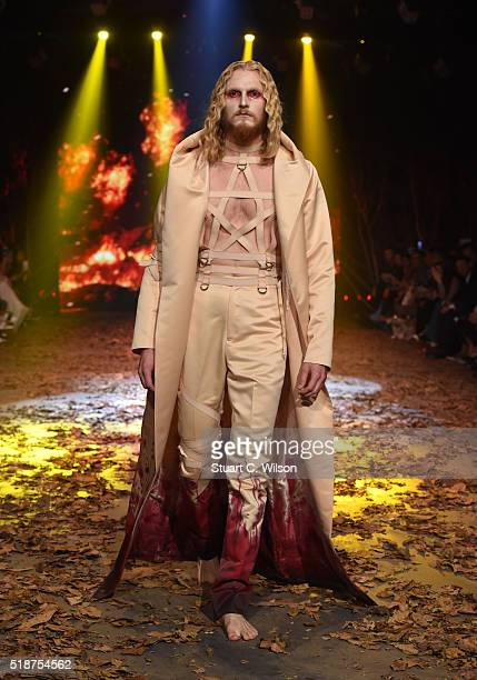 A model walks the runway during the Amato show at Fashion Forward Fall/Winter 2016 held at the Dubai Design District on April 2 2016 in Dubai United...
