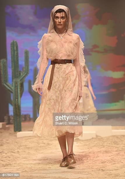 A model walks the runway during the Amato show at Fashion Forward Spring/Summer 2017 held at the Dubai Design District on October 23 2016 in Dubai...
