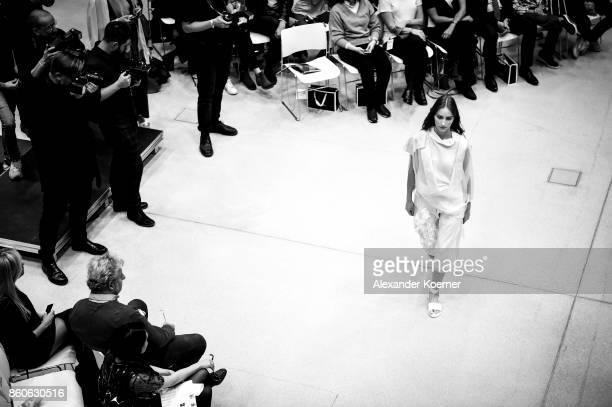 A model walks the runway during the American Women's Club And Esmod Charity Fashion Show at DRIVE Volkswagen Group Forum on October 12 2017 in Berlin...