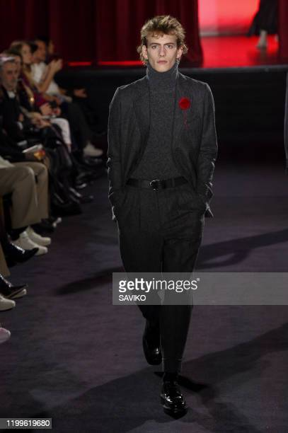 Model walks the runway during the Ami Alexandre Mattiussi Menswear Fall/Winter 2020-2021 show as part of Paris Fashion Week on January 14, 2020 in...