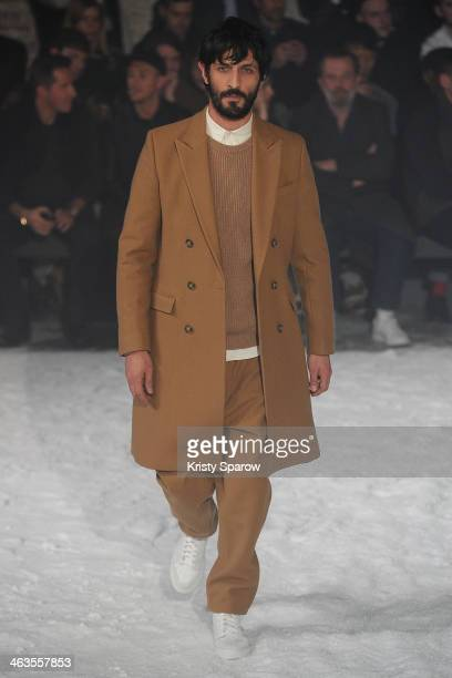 A model walks the runway during the Ami Alexandre Mattiussi Menswear Fall/Winter 20142015 show as part of Paris Fashion Week on January 18 2014 in...