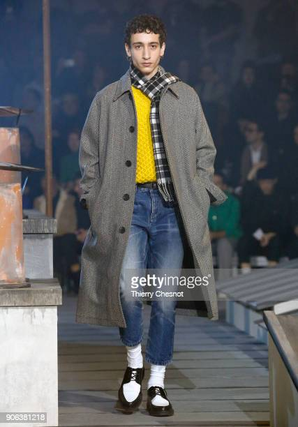 A model walks the runway during the Ami Alexandre Mattiussi Menswear Fall/Winter 20182019 show as part of Paris Fashion Week on January 18 2018 in...
