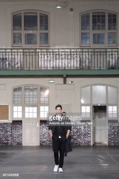 A model walks the runway during the Ami Alexandre Mattiussi show as part of the Paris Fashion Week Menswear Spring/Summer 2015 on June 28 2014 in...