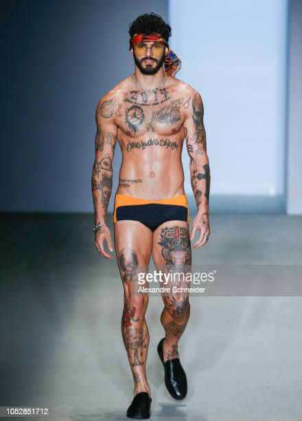 A model walks the runway during the Amir Slama fashion show during Sao Paulo Fashion Week N46 Winter 2019 at Arca on October 23 2018 in Sao Paulo...