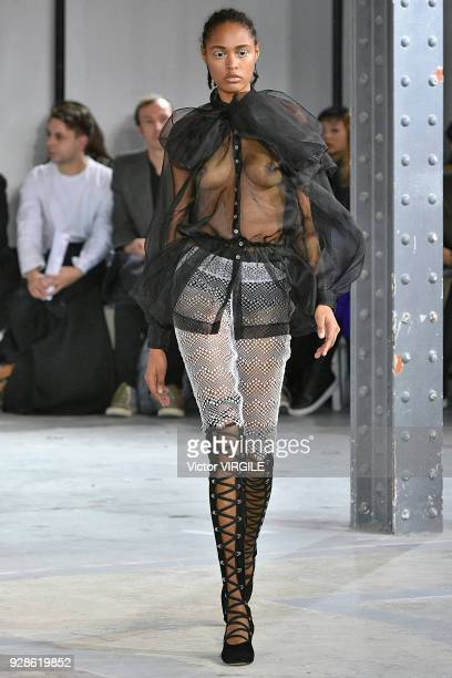 A model walks the runway during the Anais Jourden Ready to Wear fashion show as part of the Paris Fashion Week Womenswear Fall/Winter 2018/2019 on...
