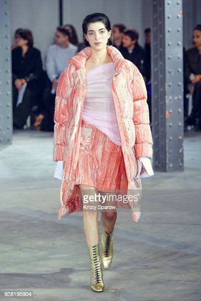 A model walks the runway during the Anais Jourden show as part of Paris Fashion Week Womenswear Fall/Winter 2018/2019 on March 6 2018 in Paris France