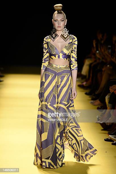 A model walks the runway during the Andre Lima show as part of the Sao Paulo Fashion Week Spring Summer 2013 on June 16 2012 in Sao Paulo Brazil