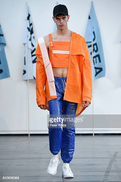 A model walks the runway during the Andrea Crews Menswear Spring/Summer 2017 show as part of Paris Fashion Week on June 23 2016 in Paris France