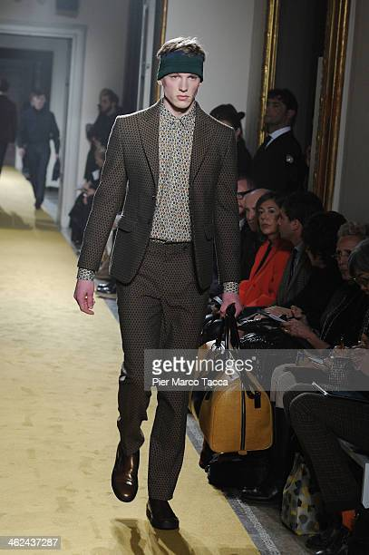 A model walks the runway during the Andrea Incontri show as a part of Milan Fashion Week Menswear Autumn/Winter 2014 on January 13 2014 in Milan Italy