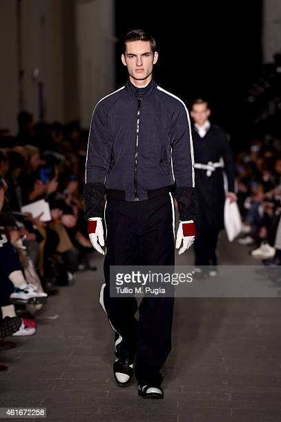 A model walks the runway during the Andrea Pompilio show as a part of Milan Menswear Fashion Week Fall Winter 2015/2016 as during the on January 17...