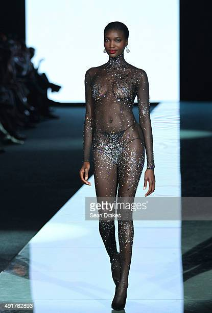 A model walks the runway during the Andres Sarda show at the Miami Fashion Week Resort 2014/2015 Day 2 at Miami Beach Convention Center on May 16...