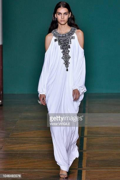 A model walks the runway during the Andrew GN Ready to Wear fashion show as part of Paris Fashion Week Womenswear Spring/Summer 2019 on September 28...