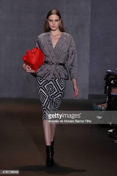 A model walks the runway during the Andrew GN show as part of the Paris Fashion Week Womenswear Fall/Winter 20142015 on March 2 2014 in Paris France