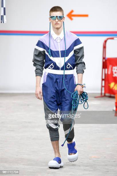 A model walks the runway during the Angus Chiang Menswear Spring/Summer 2019 show as part of Paris Fashion Week on June 21 2018 in Paris France