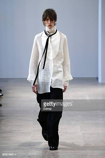 A model walks the runway during the Ann Demeulemeester designed by Sébastien Meunier Menswear Fall/Winter 20172018 show as part of Paris Fashion Week...