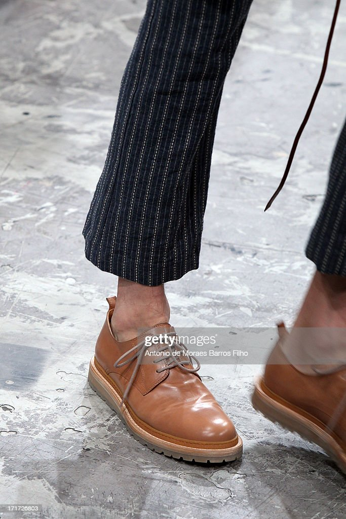A model (shoe detail) walks the runway during the Ann Demeulemeester Menswear Spring/Summer 2014 Show As Part Of The Paris Fashion Week on June 28, 2013 in Paris, France.