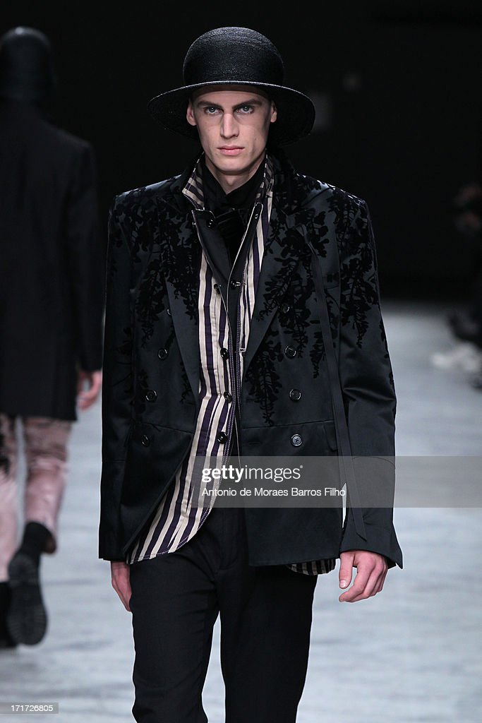 A model walks the runway during the Ann Demeulemeester Menswear Spring/Summer 2014 Show As Part Of The Paris Fashion Week on June 28, 2013 in Paris, France.