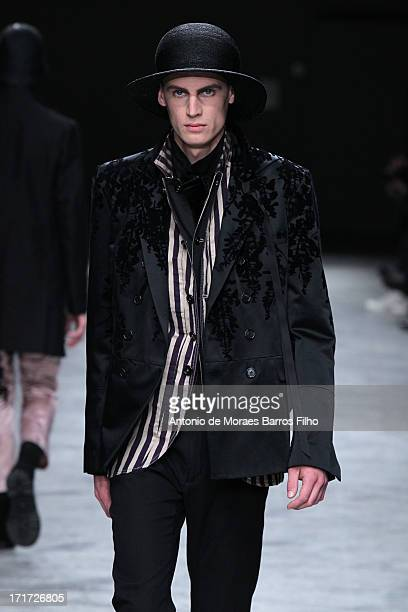 Model walks the runway during the Ann Demeulemeester Menswear Spring/Summer 2014 Show As Part Of The Paris Fashion Week on June 28, 2013 in Paris,...