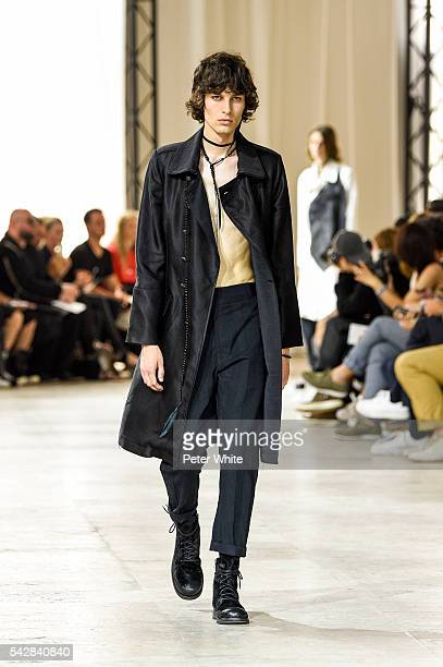 A model walks the runway during the Ann Demeulemeester Menswear Spring/Summer 2017 show as part of Paris Fashion Week on June 24 2016 in Paris France