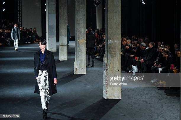 A model walks the runway during the Ann Demeulemeester Menswear Fall/Winter 20162017 show as part of Paris Fashion Week on January 22 2016 in Paris...