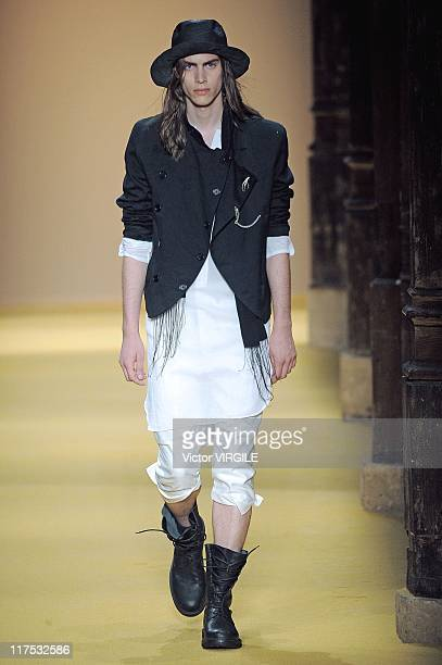 Model walks the runway during the Ann Demeulemeester Ready to Wear Spring/Summer 2012 show as part of the Paris Men Fashion Week on June 25, 2011.