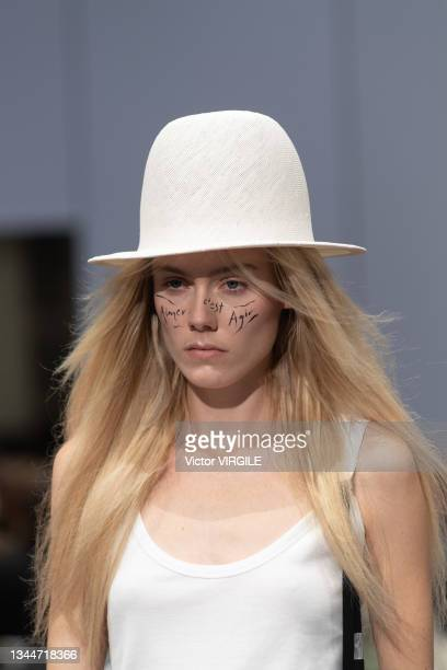 Model walks the runway during the Ann Demeulemeester Ready to Wear Spring/Summer 2022 fashion show as part of the Paris Fashion Week on October 3,...