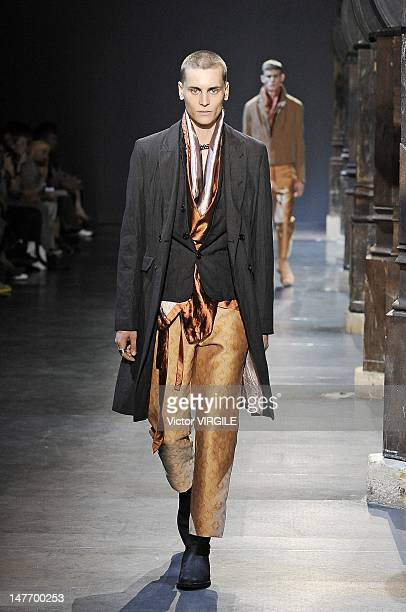 Model walks the runway during the Ann Demeulemeester Ready to Wear Spring/Summer 2013 show as part of the Paris Men Fashion Week on June 29, 2012 in...
