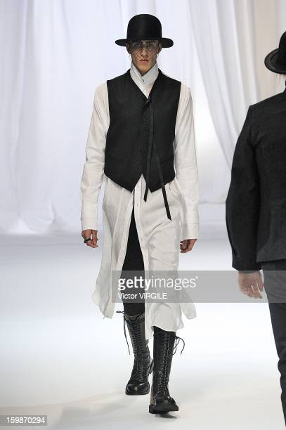 A model walks the runway during the Ann Demeulemeester Ready to Wear Fall/Winter 20132014 show as part of Paris Fashion Week on January 18 2013 in...