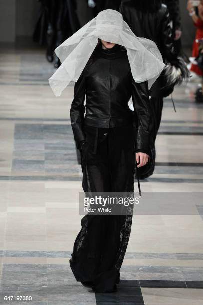 Model walks the runway during the Ann Demeulemeester show as part of the Paris Fashion Week Womenswear Fall/Winter 2017/2018 on March 2, 2017 in...