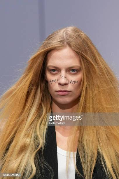 Model walks the runway during the Ann Demeulemeester Womenswear Spring/Summer 2022 show as part of Paris Fashion Week on October 03, 2021 in Paris,...