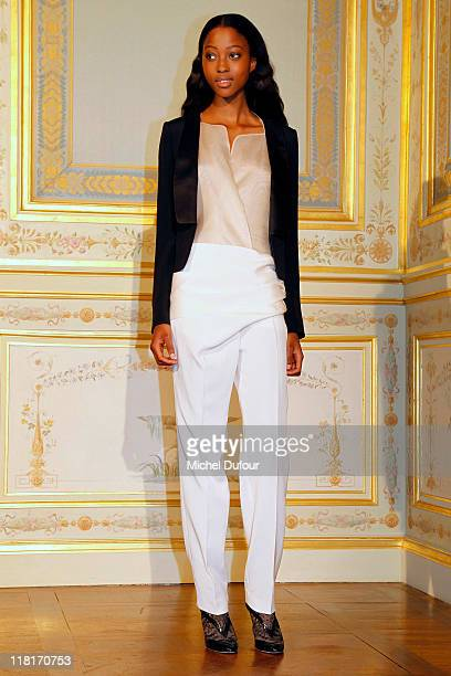 A model walks the runway during the Anne Valerie Hash Haute Couture Fall/Winter 2011/2012 show as part of Paris Fashion Week at Hotel ShangriLa on...